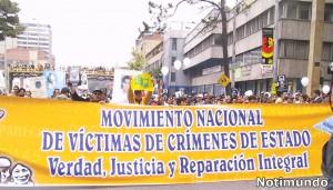 Movimiento de Víctimas de Crímenes de Estado. Marcha . Pancarta. Notimundo
